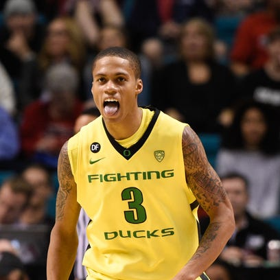 March 12, 2015; Las Vegas, NV, USA; Oregon Ducks guard Joseph Young (3) celebrates after making a three-point basket against the Colorado Buffaloes during the first half in the quarterfinal round of the Pac-12 Conference tournament at MGM Grand Garden Arena. Mandatory Credit: Kyle Terada-USA TODAY Sports