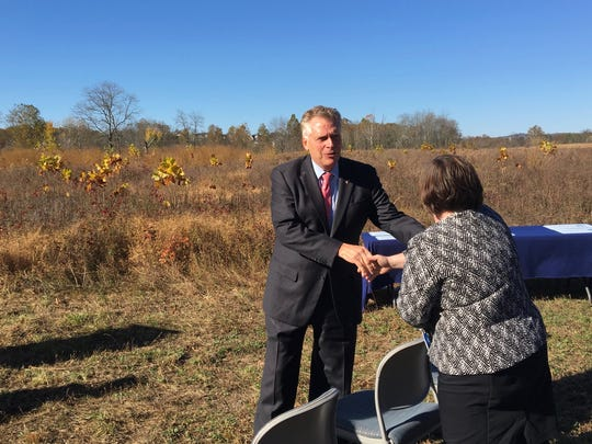Gov. Terry McAuliffe shakes hands with an attendee ahead of his announcement of the first project using funds from the DuPont South River Settlement at Cowbane Prairie Natural Area Preserve in Stuarts Draft, Va., on Tuesday, Oct. 31, 2017.