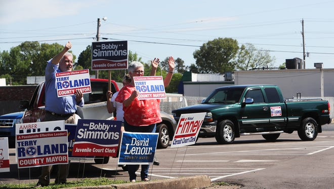 May 1, 2018 - Terry Roland (left), a Republican running for Shelby County Mayor, and his sister-in-law, Kathy Jones, campaign at the Baker Community Center in Millington on Tuesday.