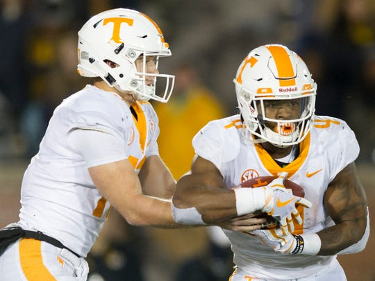 Tennessee quarterback Will McBride (17) hands the ball to Tennessee running back John Kelly (4) during a game between Tennessee and Missouri at Faurot Field in Columbia, Missouri, on Saturday November 11, 2017.