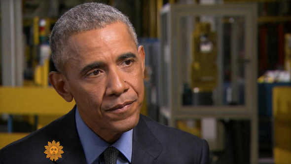 President Obama talks with CBS News reporter Lee Cowan