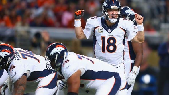 Peyton Manning #18 of the Denver Broncos audibles at