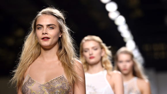 Cara Delevingne and her eyebrows stand out from the