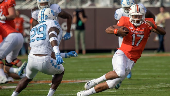 Virginia Tech quarterback Josh Jackson (17) gains yardage against North Carolina safety J.K. Britt (29) during the first half of an NCAA college football game, Saturday, Oct. 21, 2017, at Lane Stadium in Blacksburg.