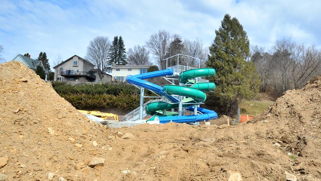 Construction workers work on the renovation of Kaiser Pool near Thom Field in Wausau last month.