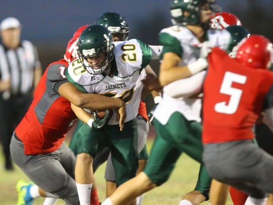 Desert Mirage High School's defense stops a run against Palo Verde Valley during the Rams game at home in Thermal.