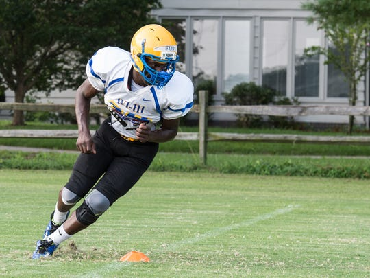 A Wi-Hi player practices a running play at Wicomico High School on Thursday, Aug. 17.