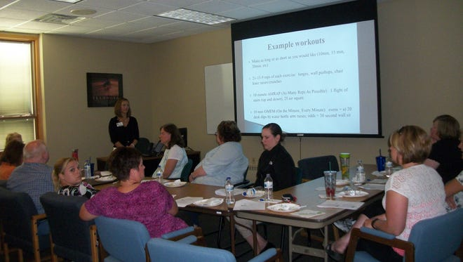 Jackson Kaul Insurance Services employees participate in a Lunch-N-Learn session.