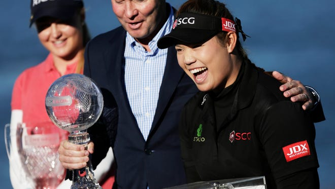 Ariya Jutanugarn of Bangkok, Thailand celebrates winning the Race to the CME Globe and Rolex Player of the Year during the award ceremony after the CME Group Tour Championship at Tiburon Golf Club in Naples, Fla. on Sunday, Nov. 20, 2016.