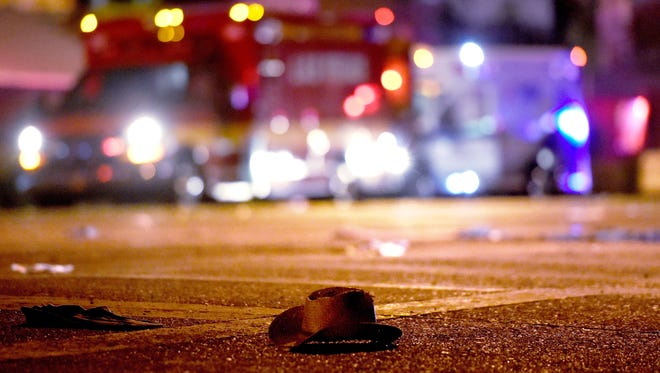 A cowboy hat lays in the street after shots were fired near a country music festival on October 1, 2017 in Las Vegas, Nevada. A gunman has opened fire on a music festival in Las Vegas, leaving at least 20 people dead and more than 100 injured. Police have confirmed that one suspect has been shot. The investigation is ongoing.