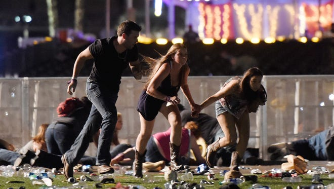 People run from the Route 91 Harvest country music festival amid gunfire on Oct. 1, 2017 in Las Vegas.