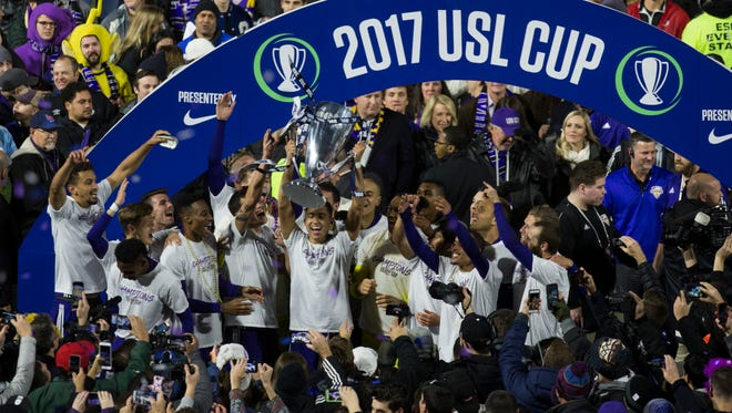 Louisville City FC celebrates after winning the USL Cup match 1-0 against the Swope Park Rangers on Monday evening at Louisville Slugger Field. Nov. 13, 2017