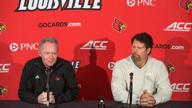 University of Louisville football coach Bobby Petrino, left, introduced Brian VanGorder, right, as the team's new defensive coordinator. Jan. 31, 2018.