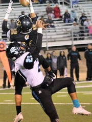 Alamogordo's Julio Mendoza jumps up to grab a pass.