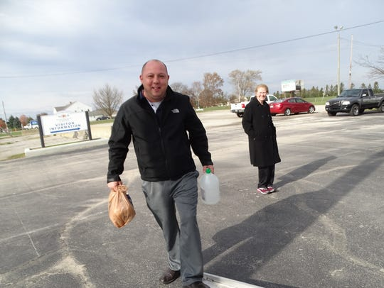 Fremont Mayor Danny Sanchez carries donated items onto