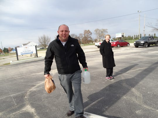 Fremont Mayor Danny Sanchez carries donated items onto the box truck to be donated to families.