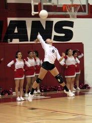 Eliza Ortiz of Cobre had her jump serve going. She