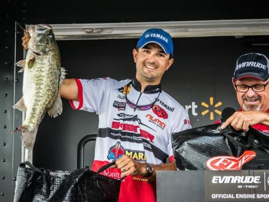 Nick LeBrun holds up a bass that helped him become a points leader on an FLW trail.