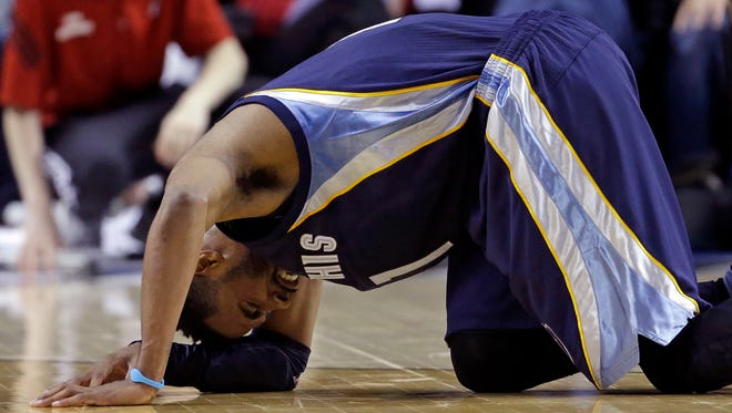 Memphis Grizzlies guard Mike Conley grimaces in pain on the floor after a collision during the second half of Game 3 of a first-round NBA basketball playoff series against the Portland Trail Blazers in Portland, Ore., Saturday, April 25, 2015. Conley left the game and did not return.  The Grizzlies won 115-109 to lead the series 3-0.