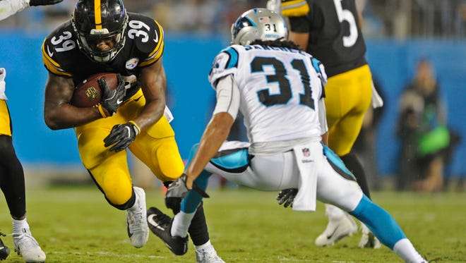 Steelers running back Terrell Watson (39) tries to slip past the Panthers' Zack Sanchez during a preseason game on Aug. 31. Watson, an Oxnard High graduate, led the NFL in rushing during the preseason and earned a spot on Pittsburgh's regular-season roster.