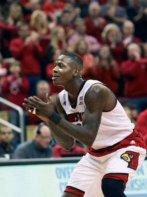 Louisville's Terry Rozier claps as he gets back on defense after making a layup.  March 7, 2015