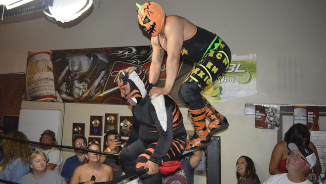 Midget wrestlers battle it out during Midget Mania at The Stag in Exeter on Sunday.