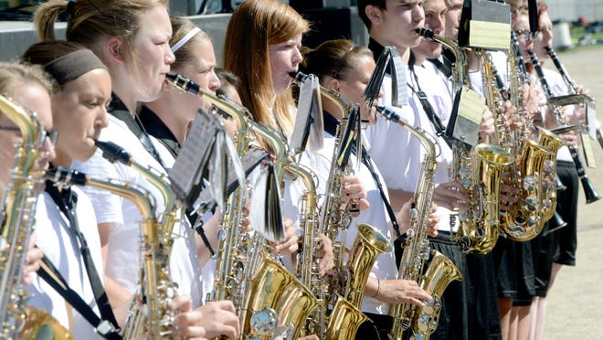 In this file photo from September 2016, members of the Triway High School marching band perform in front of the grandstand at the Wayne County Fair.