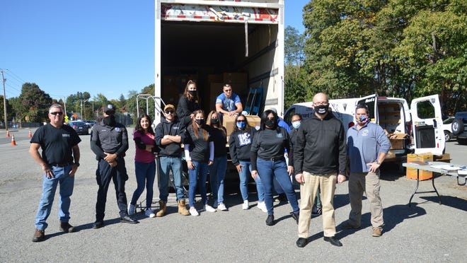 The group of volunteers that helped out at the food box distribution at Doyle Field in Leominster on Friday, Oct. 9 gather for a photo.