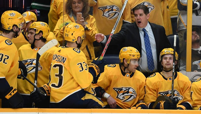 Nashville Predators head coach Peter Laviolette sets his lineup as overtime resumes after a goal was overturned for an offsides call against the Minnesota Wild at Bridgestone Arena on March 27, 2018.