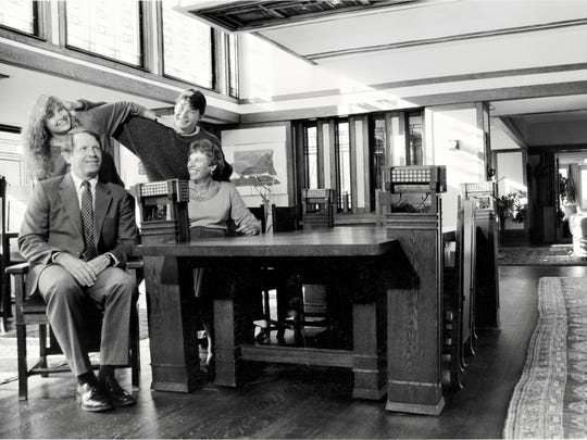 Kim Bixler (top left) and family in the Wright House, where they lived for 17 years.