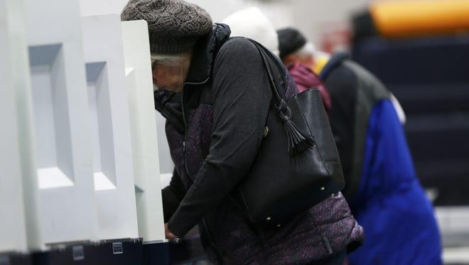 People mark their voting ballots in the gym at Wausau West High School Tuesday morning, April 3, 2018.