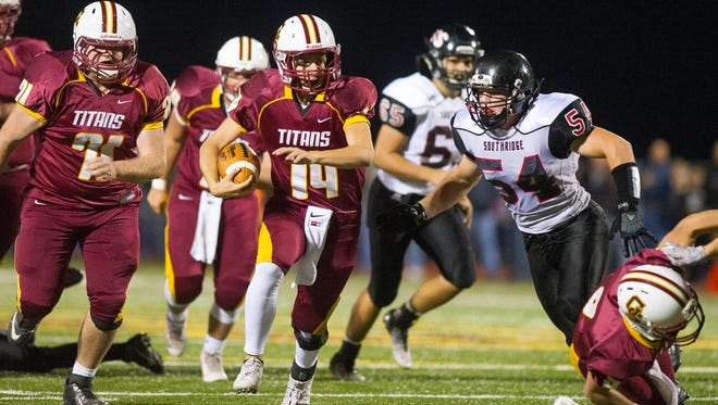 Gibson Southern's Isaac Sellers (14) runs the ball past Southridge's Donnie Kramer (54)during their game at Jewell Memorial Field in Fort Branch, Friday, Oct. 14, 2016. Gibson Southern beat Southridge 38-35.