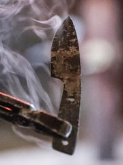 James Wahls Sr. pulls one of his custom knives from