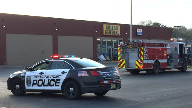Stevens Point's police and fire departments respond to a fire May 7 at Dollar General. An employee at the store, 18-year-old Brian Kraus, is accused of intentionally starting the fire.