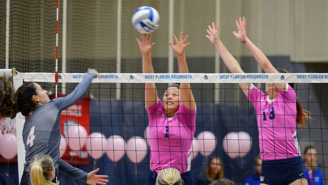 West Florida's Monique StCyr and Rachel Neblett go up for the block Saturday, October 21, 2017 during the Pack it Pink game against West Alabama at the UWF Field House.