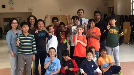 The Hartshorn School Chess Team with parent coaches, from left, Li Pan, Randi Kates, and Vivek Modi, and Hartshorn Principal Kenneth Frattini, celebrate an undefeated season.