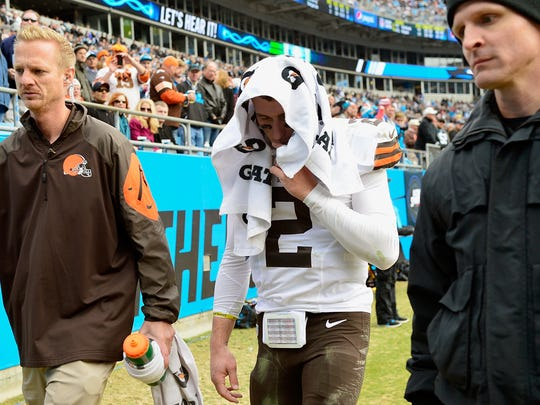 Johnny Manziel #2 of the Cleveland Browns leaves the field after being injured during their game against the Carolina Panthers at Bank of America Stadium on December 21, 2014 in Charlotte, North Carolina.