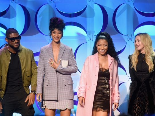 From left, Usher, Rihanna, Nicki Minaj and Madonna appear at the Tidal launch event #TIDALforALL at Skylight at Moynihan Station on March 30, 2015, in New York City.