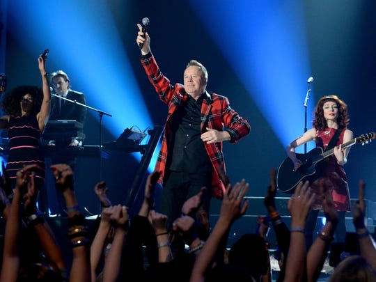 Singer Jim Kerr of Simple Minds performs onstage during