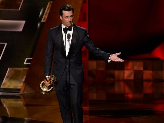Jon Hamm accepts the Emmy for lead actor for 'Mad Men.'