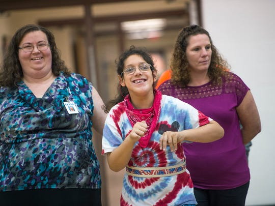 MOVE student Ali Havens, 20, enters the Broome Tioga BOCES gymnasium during a Mobility Parade on Friday.