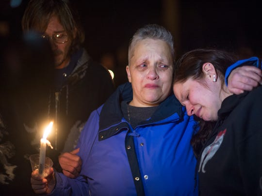Left, Patricia Baxter, of Castle Creek, mother of Jessica Baxter, who was hurt in the Oct. 19, 2015 arson fire in Johnson City, hugs her daughter Angel Baxter, of Binghamton, during a vigil last year.