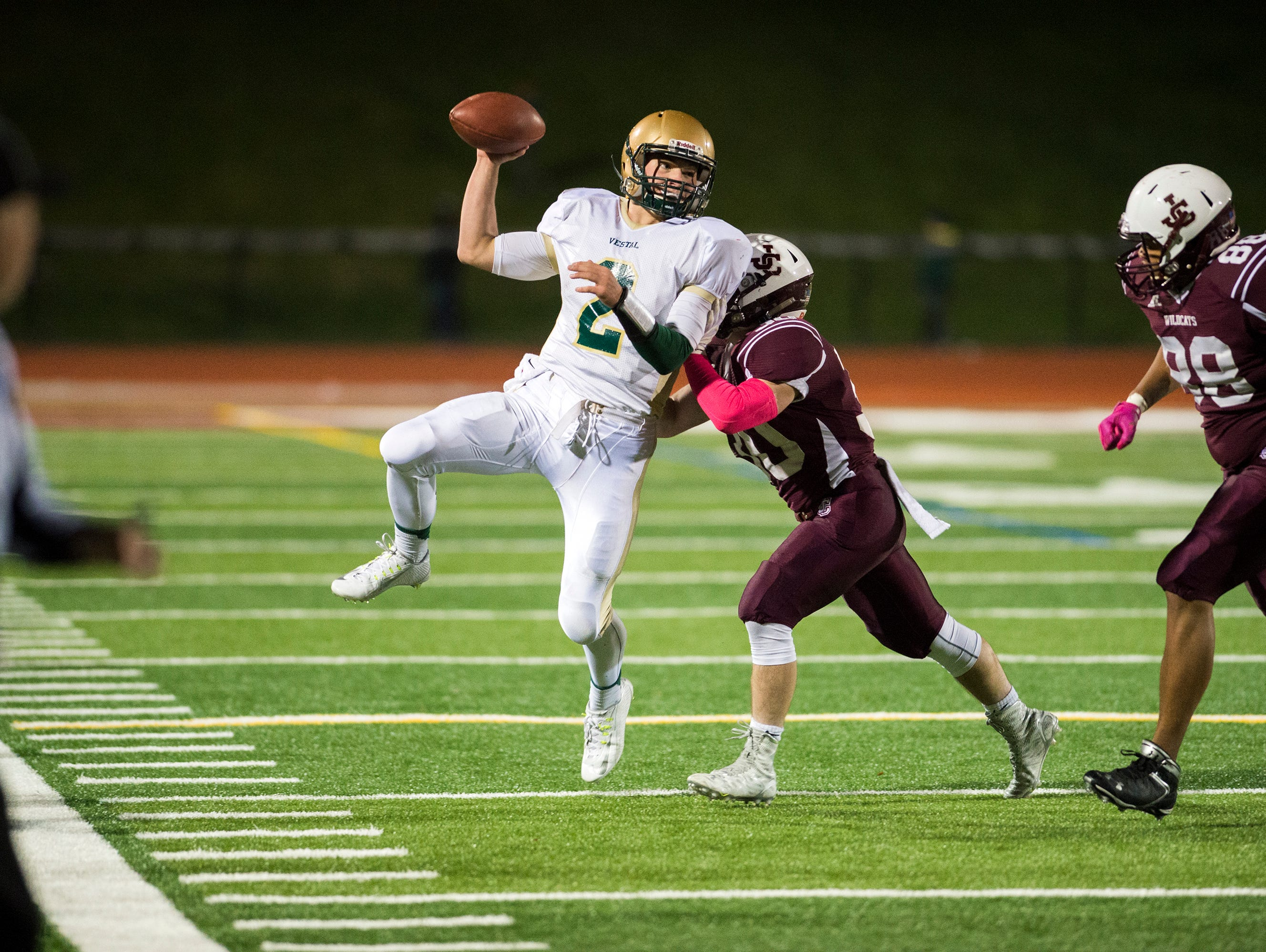 Vestal quarterback TJ Wegmann is throws as he is hit out of bounds by Johnson City defender Alex Sprague-Getsy during the second quarter of JC's 29-6 win in the Section 4 Class A semifinal playoff game on Friday.