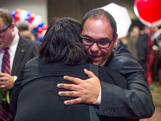 Republican City Councilman Giovanni Scaringi is congratulated Tuesday after his win was announced.