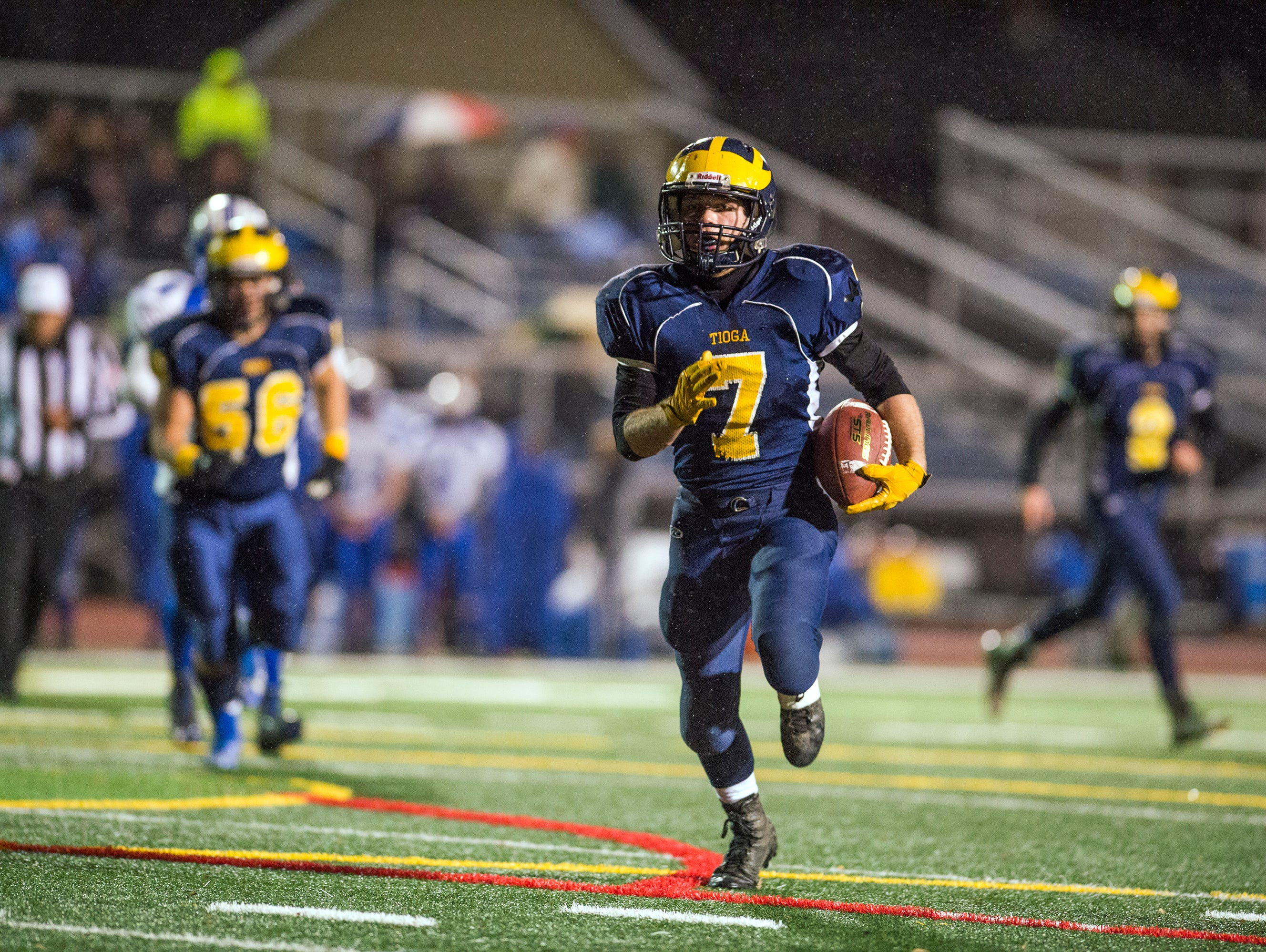 Tioga running back Jesse Manuel rushes for a touchdown during the second quarter of the Tiger's Class D state quarterfinal playoff game against Sandy Creek at Binghamton Alumni Stadium on Friday, Nov. 13, 2015.