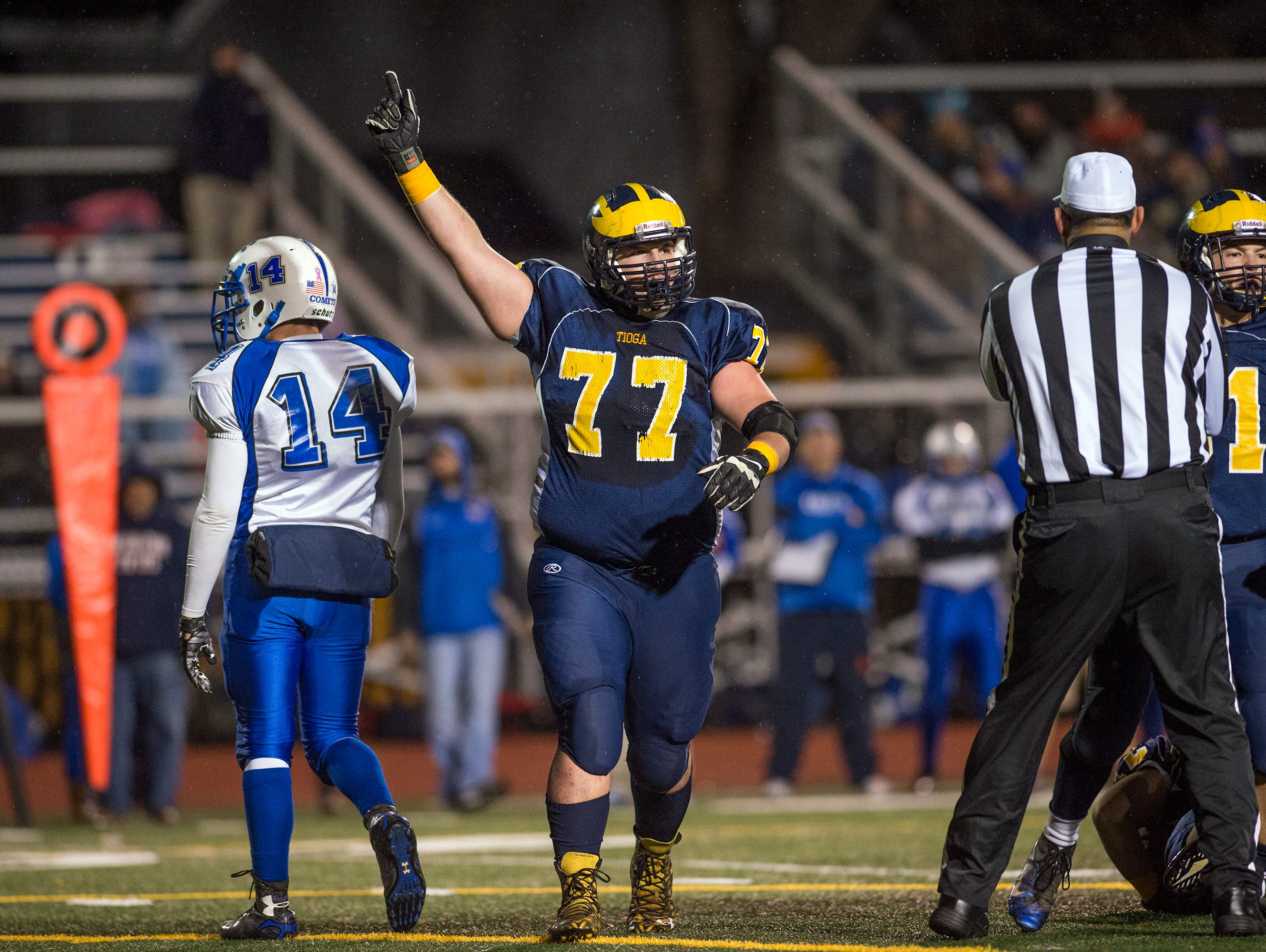 Tioga defensive lineman Hunter Boyle celebrates after the Tigers recovered a fumble during the first quarter against Sandy Creek in the Class D state playoff quarterfinal game at Binghamton Alumni Stadium on Friday, Nov. 13, 2015.