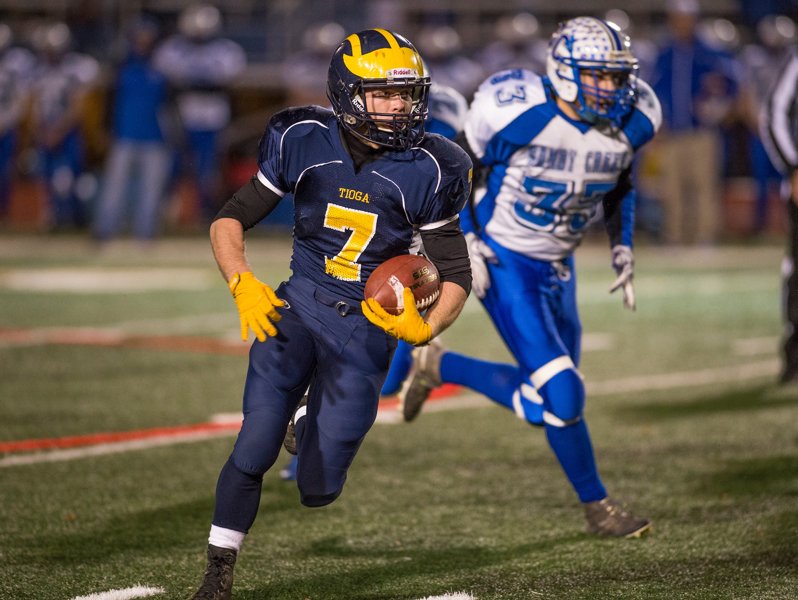Tioga running back Jesse Manuelturns upfield during the first quarter of the Tiger's Class D state quarterfinal playoff game at Binghamton Alumni Stadium on Friday, Nov. 13, 2015.