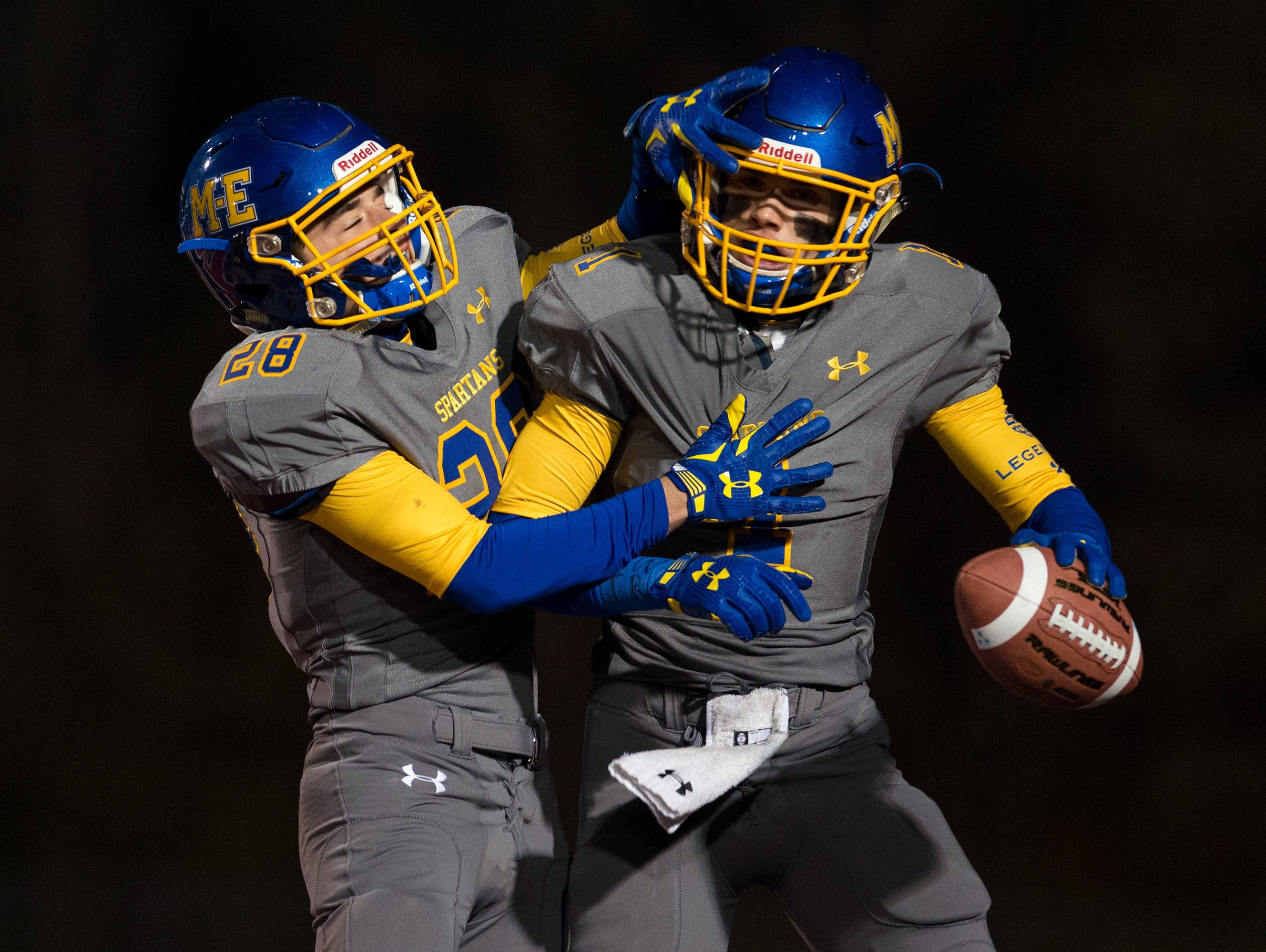 Maine-Endwell running back Andrew Grassi, left, celebrates wide receiver Michael Palmer's touchdown reception during the first quarter of M-E's Class A state quarterfinal playoff game against Whitesboro on Friday in Binghamton.