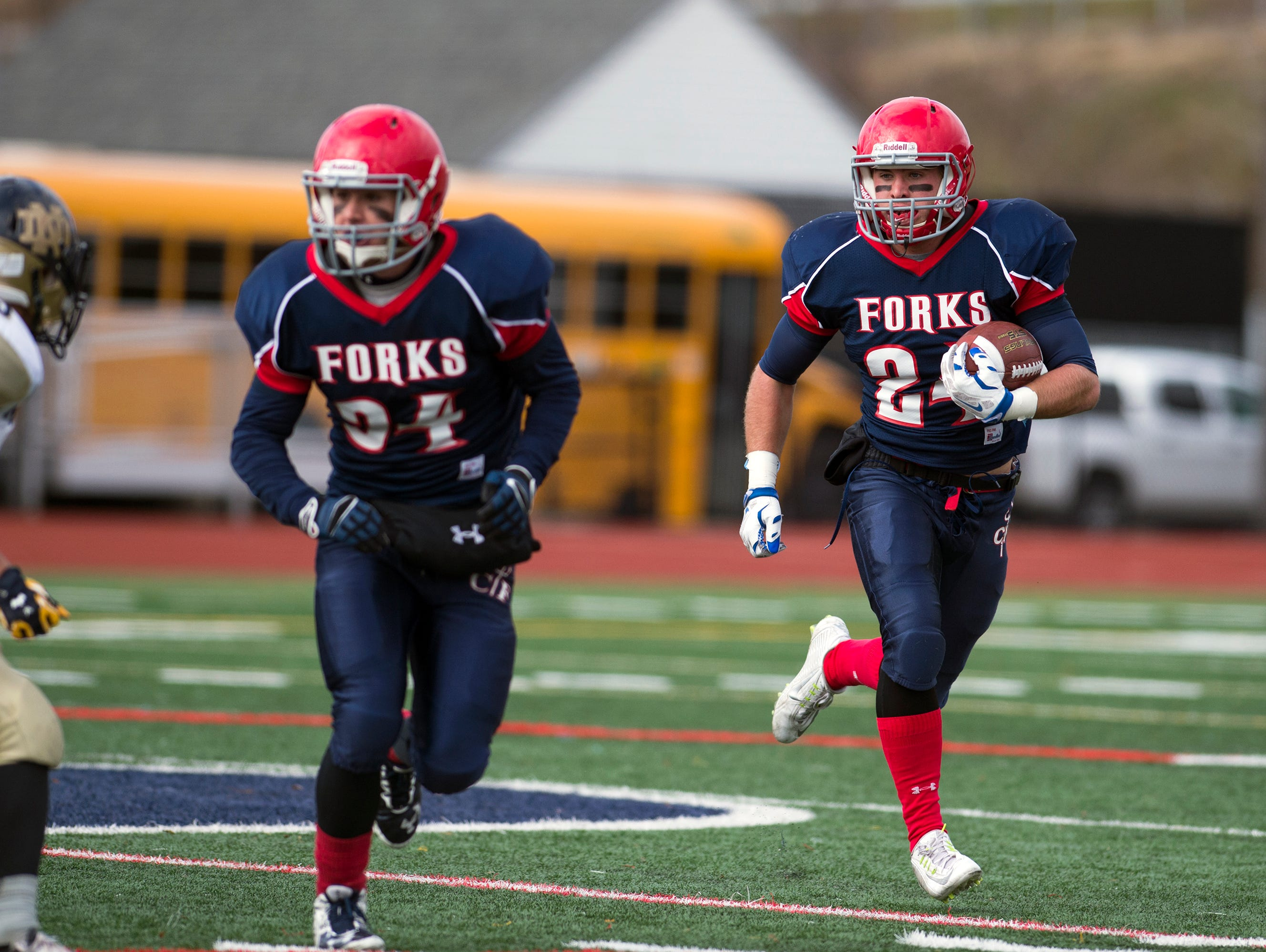 Chenango Forks running back Dylan Studer rushes during the Blue Devil's 35-8 win over Utica Notre Dame to advance to the Class C state semifinals on Saturday, Nov. 14, 2015 at Binghamton Alumni Stadium.