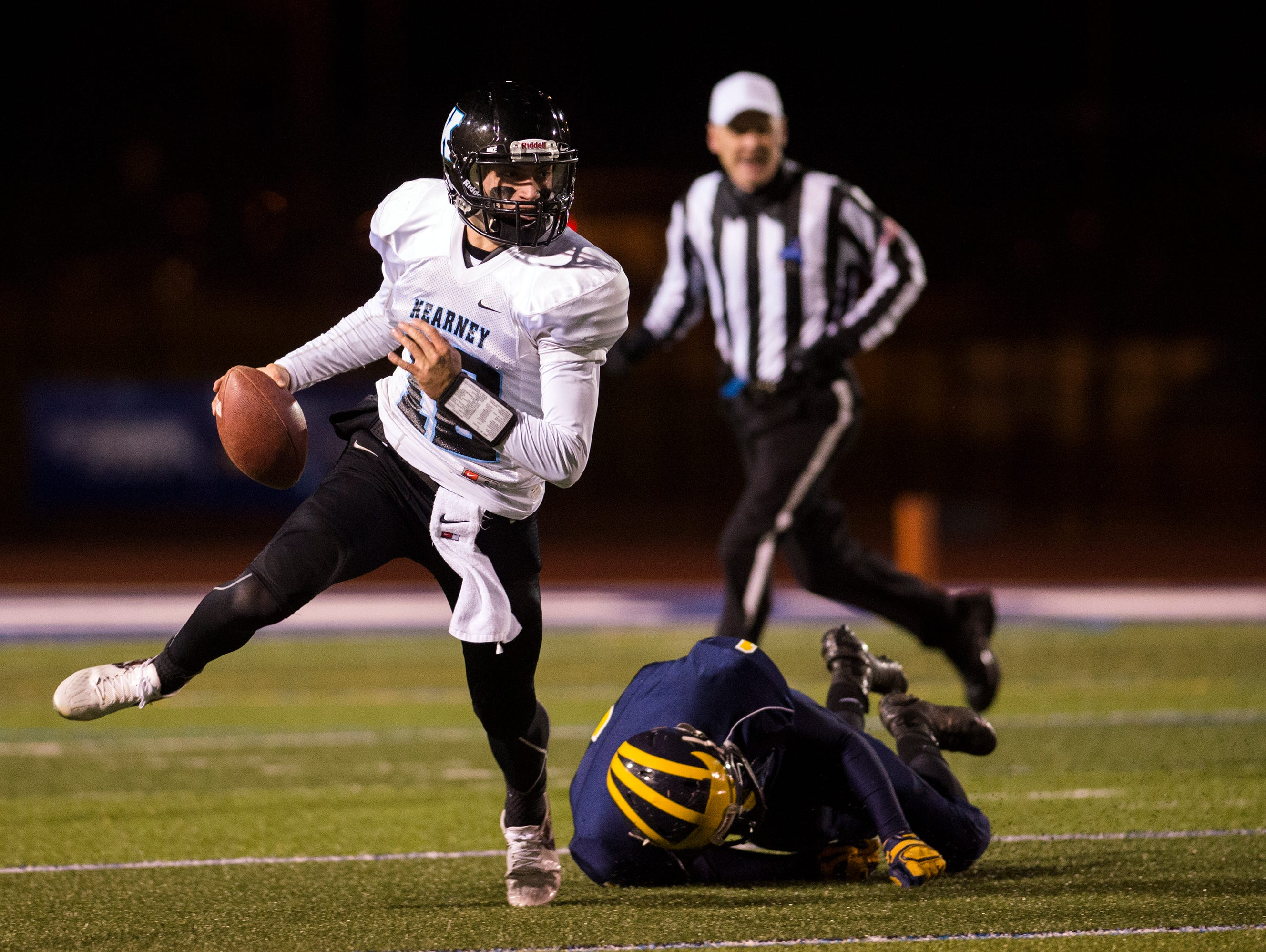 Bishop Kearney quarterback Todd LaRocca eludes a defender during the first quarter against Tioga in the Class D state playoff semifinals at Cicero-North in Syracuse on Friday, Nov. 20, 2015.